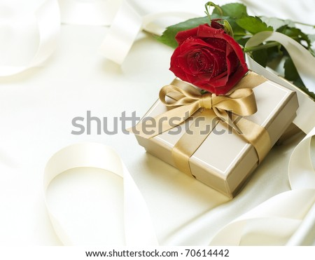 Valentine gift over white silk - stock photo