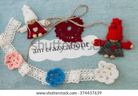 Valentine, greeting card with knitting red hearts, flowers and couple in love. Lettering I am crazy about you on the denim background. Handmade concept - stock photo