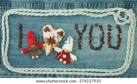 Valentine, greeting card with textile coffee heart, coffee beans and knitted loving couple man and woman. Lettering coffee beans I love you on the denim background. Handmade concept - stock photo
