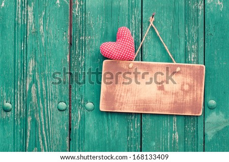 Valentine heart and sign board on wooden vintage background - stock photo