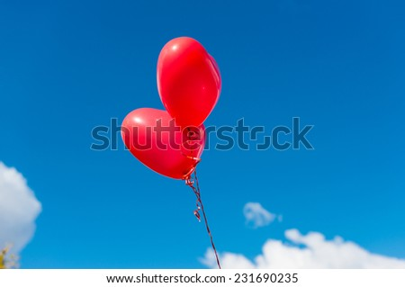 Valentine heart balloon against blue sky background