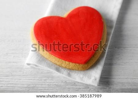 Valentine heart cookie on wooden background - stock photo