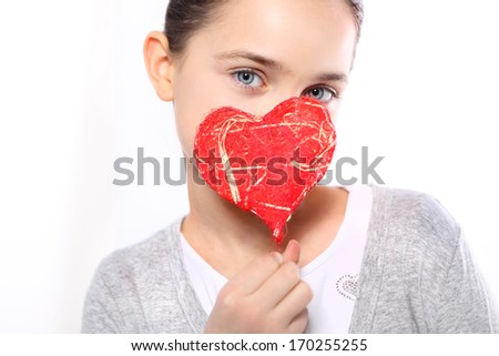 Valentine heart / Cute Caucasian girl holding a red Valentine heart