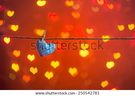 Valentine heart hanging on the clothesline. Copy space. Image of Valentines day.  - stock photo