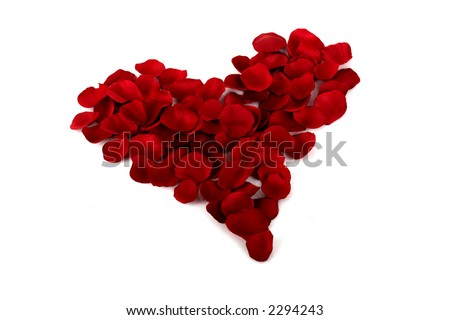 Valentine heart made with red rose petals - stock photo