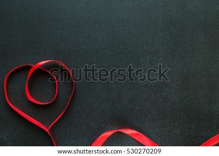 Valentine heart on black chalkboard. Valentine's day