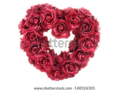 Valentine heart shape made from red roses.