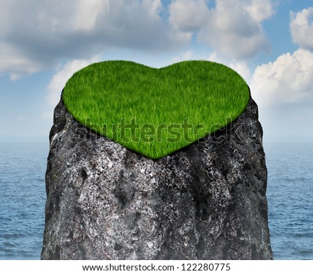 Valentine heart shaped mountain cliff island surrounded by water as a lonely and romantic symbol of the challenges of dating and searching for a loving relationship and abstinence from sex. - stock photo