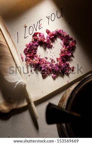 Valentine. 'I love you', heart on the old paper and feather pen. - stock photo