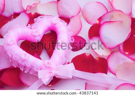 Valentine illustration: petals and heart on a background of silk - stock photo
