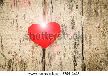 Valentine love symbol on a wooden board old look - stock photo