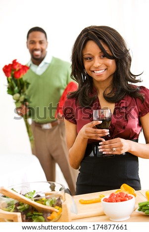 Valentine: Man Surprising Woman With Flowers and Candy - stock photo
