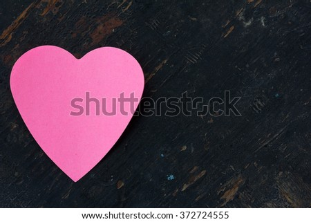 Valentine - paper pink heart against a black wooden background. Copy space. Free space for text, Close-up, top view - stock photo