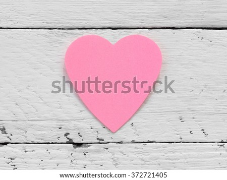 Valentine - paper pink heart against a white painted surface. Copy space. Free space for text, Close-up, top view - stock photo