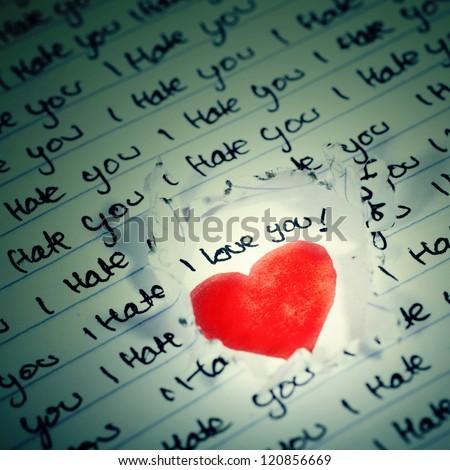 Valentine Photo Concept: Love beneath the I hate you words - stock photo