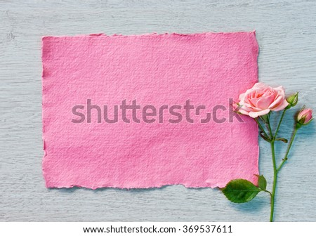 Valentine pink card and pink rose on a white wooden background. Valentines Day concept - stock photo