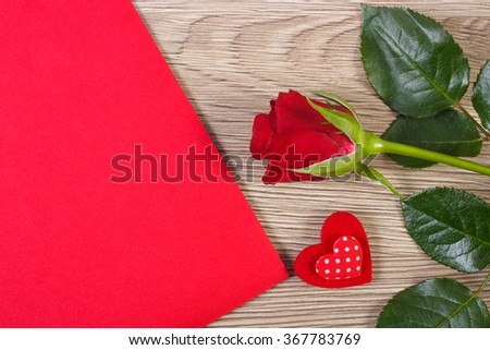 Valentine red heart, rose and love letter in red envelope on wooden background, decoration for Valentines Day, symbol of love - stock photo