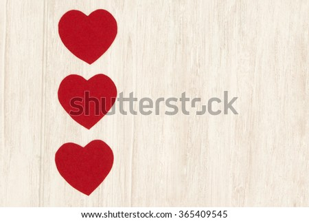 Valentine red hearts on grey wooden background - stock photo