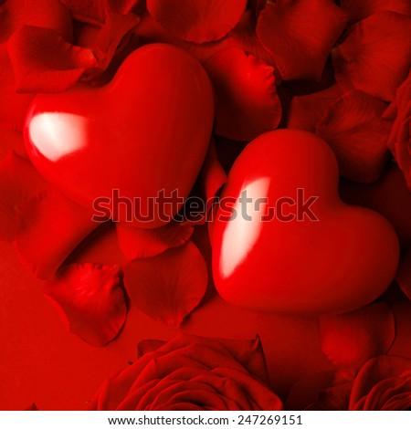 Valentine red hearts on red silk background. Valentine's Day - stock photo