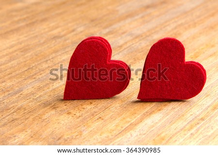 Valentine red hearts on rustic wooden background - stock photo
