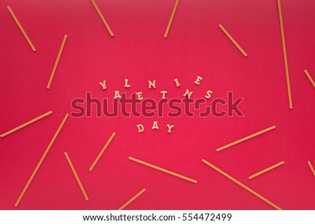 Valentine's background with raw pasta on pink