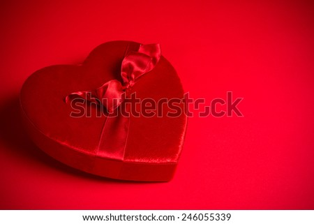 Valentine's candy box on a red background with copy space - stock photo