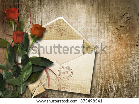 Valentine's card with envelope and roses in vintage wooden backg