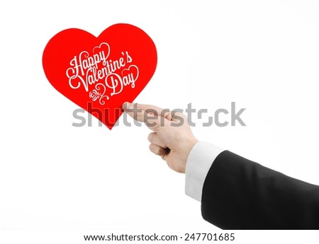 Valentine's Day and love theme: man's hand in a black suit holding a card in the form of a red heart with the words Happy Valentine's Day, isolated on a white background in studio - stock photo