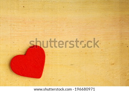 Valentine's day background. Red decorative heart on wooden table with copy space