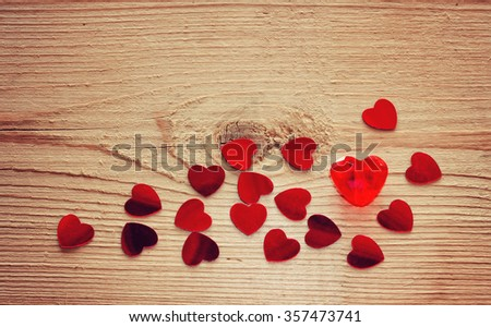 Valentine's day background with confetti, heart on the wooden table