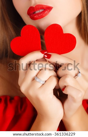 Valentine's Day. Beautiful young woman with heart in her hands. Young woman with red heart on white background. portrait of attractive smiling woman isolated on white studio shot with hearts. close up