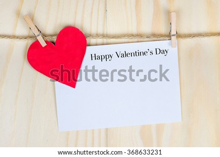valentine's day card hanging with a rope - stock photo