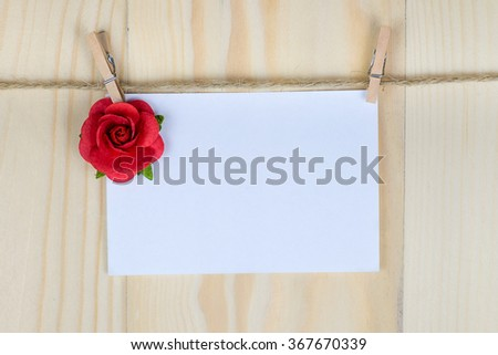 valentine's day card hanging with a rope. for input your text here. - stock photo