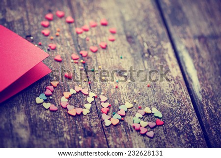 "Valentine's day card with small hearts on wooden background and word ""LOVE""/ romantic love background - stock photo"