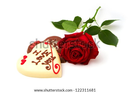 Valentine's Day concept. Heart shape chocolate and red rose on white background - stock photo