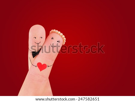 Valentine's Day concept - hug a man and a woman couple hold on the red heart, painted at fingers against red background - stock photo