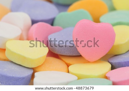 Valentine's Day conversation hearts, with room for personalized text on the pink heart. - stock photo