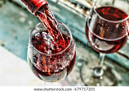 valentines day date love celebration pouring red wine wine in a