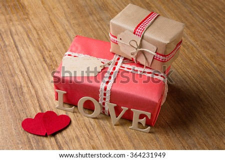 Valentine's Day. Decorative boxes and felt hearts - stock photo