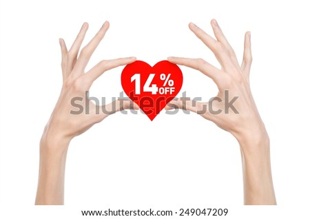 Valentine's Day discounts topic: Hand holding a card in the form of a red heart with a discount of 14% on an isolated white background in studio - stock photo
