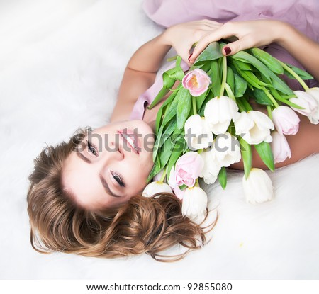 Valentine's Day - Dreaming Voluptuous Young Woman with Bouquet of Flowers. Series of photos - stock photo