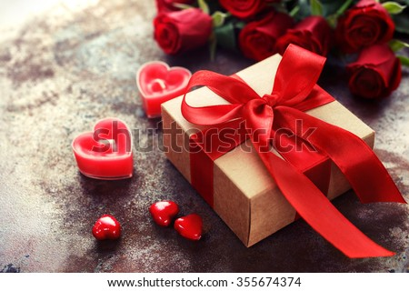 Valentines day gift box kraft paper 355674374 shutterstock valentines day gift box of kraft paper with a red ribbon and candles rustic negle Gallery