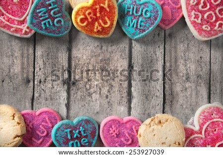 Valentine's day greeting card template with cookies on a vintage table - stock photo