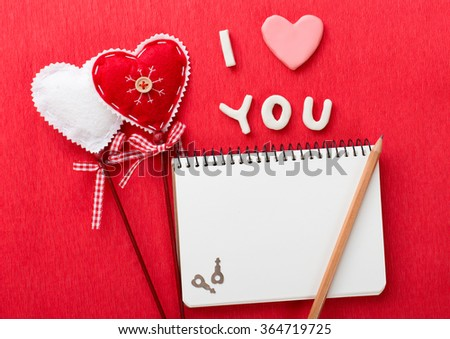 Valentine's Day greeting card with hearts and notebook. With copy space - stock photo