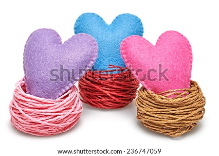 Valentine's Day. Hearts Handmade in Nest. Love concept on white background - stock photo