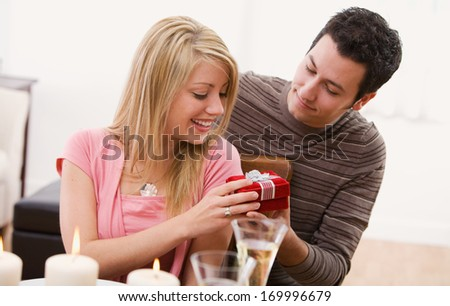 Valentine's Day holiday series with young Caucasian couple enjoying a romantic dinner together.
