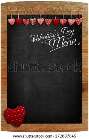 Valentine's Day Menu Chalkboard Fabric Love hearts hanging on wooden texture background, big red heart  in corner, copy space for love message - stock photo