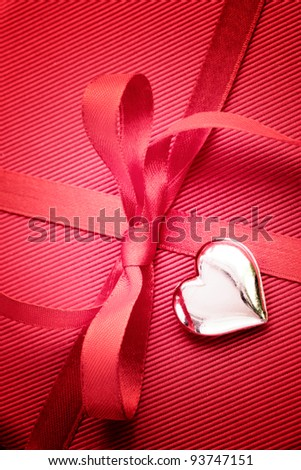 Valentine's day red bow on luxury present - stock photo