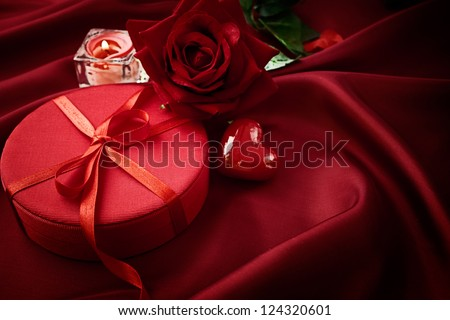 Valentine's day red bow on luxury present with beautiful neklace - stock photo