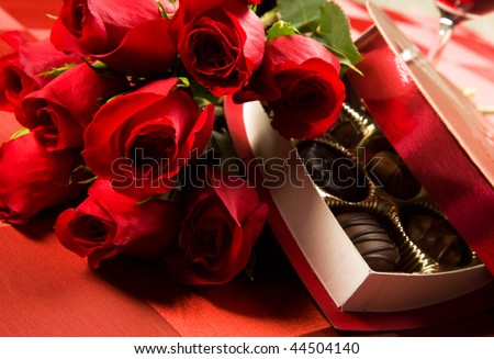 Valentine's day roses, candies and wine on black tray